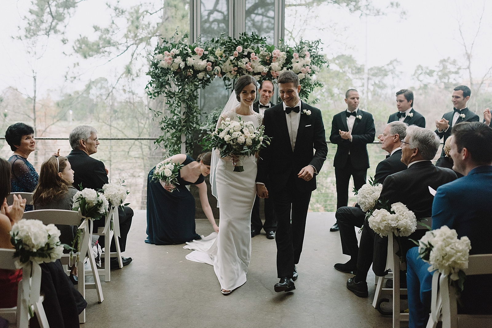 Bride and groom's wedding recessional on the terrace of the Dunlavy