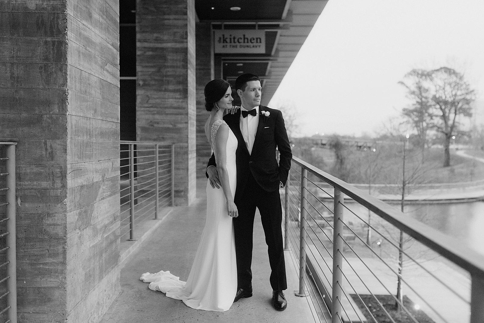 Rainy day bridal portraits on the patio overlooking downtown Houston and Buffalo Bayou
