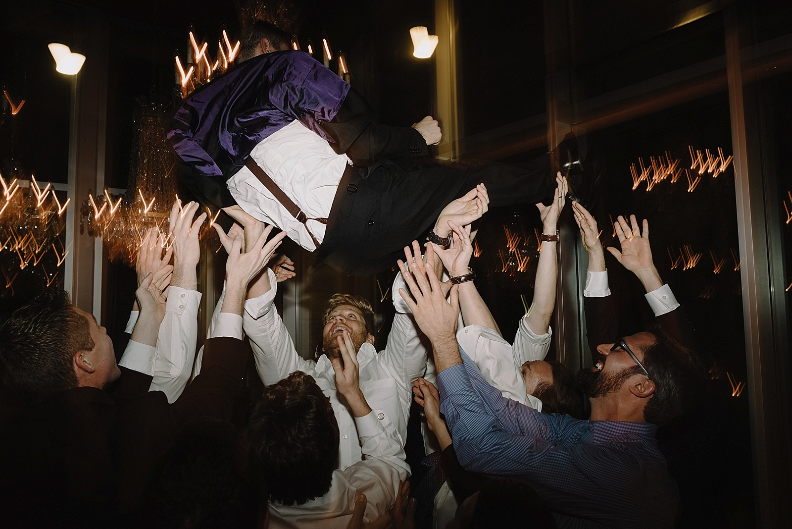 Groom being tossed in the air by his groomsmen at the Dunlavy in Houston