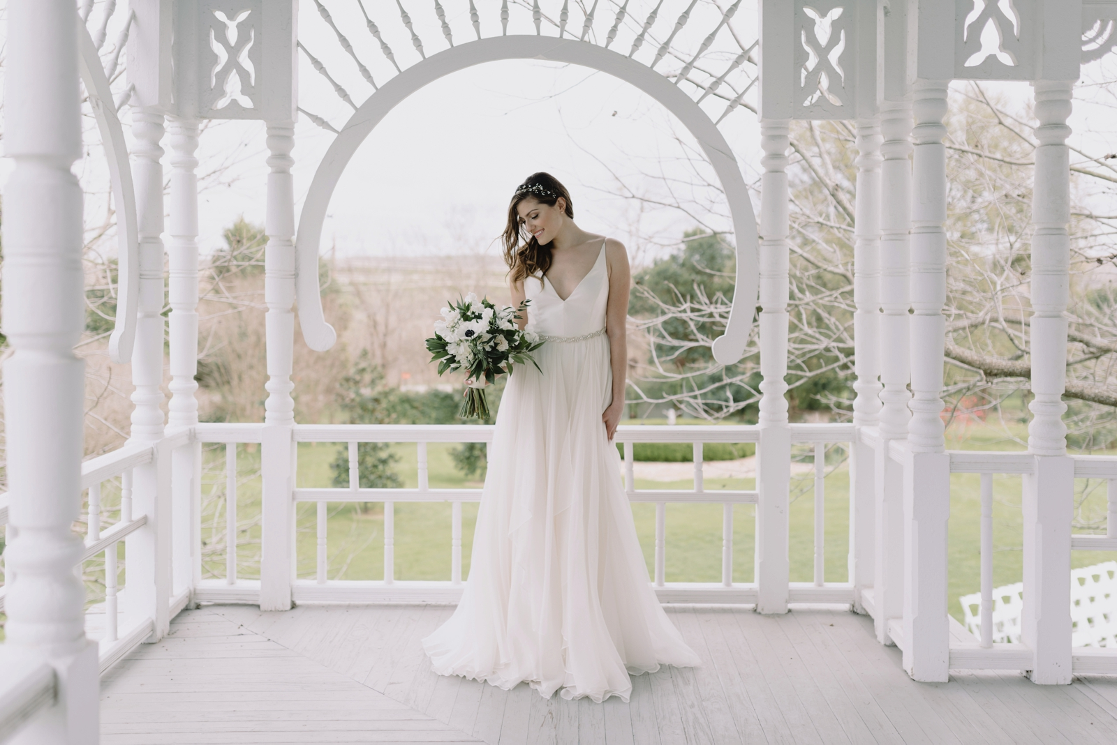 Timeless bridal portrait on the upper patio of the Barr Mansion homestead