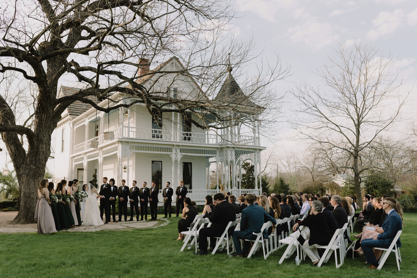 Wedding ceremony under the pecan tree at Barr Mansion on the outskirts of Austin