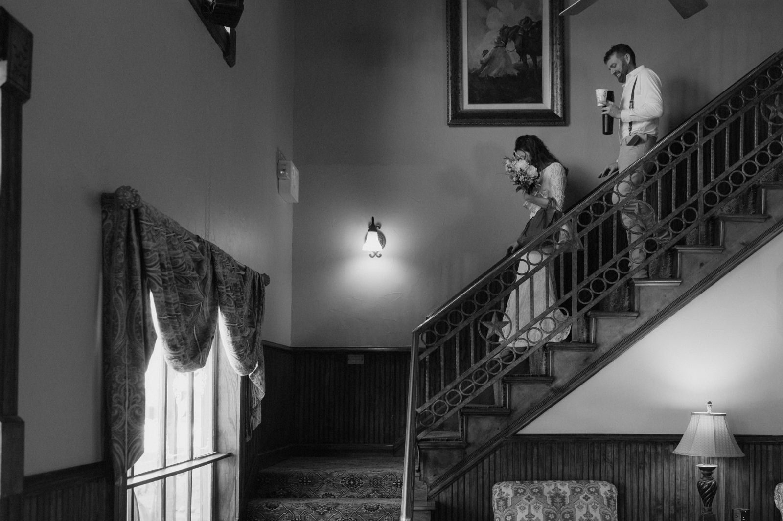 Couple descending the stairs at Lajitas Golf Resort for their Big Bend elopement