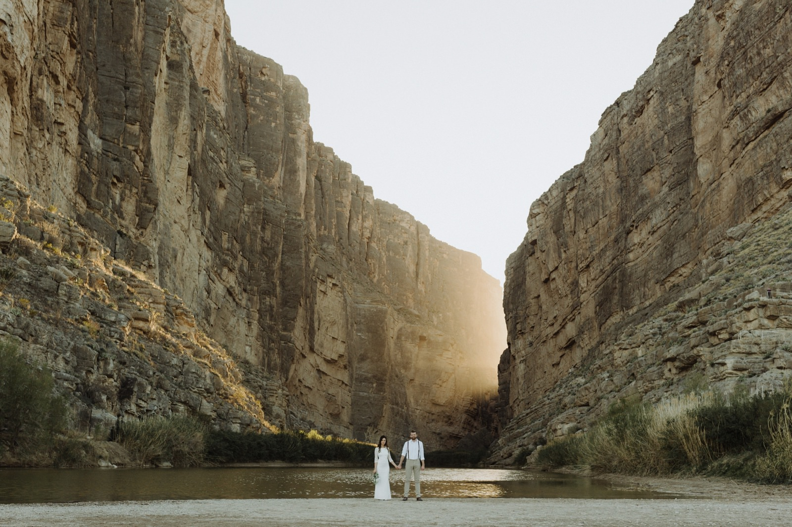 Sunset elopement portraits at Santa Elena Canyon with light pouring in through the rock walls
