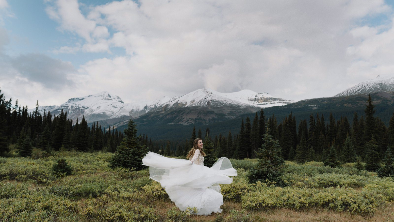 Bride spinning in her tulle dress in Banff National Park