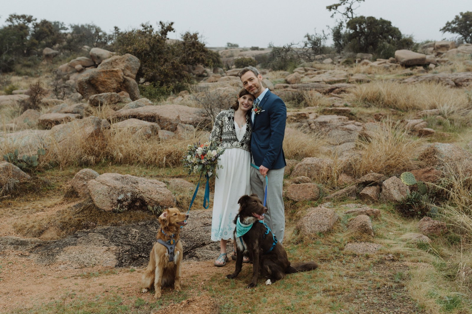A couple posing with their dogs at their elopement in Texas