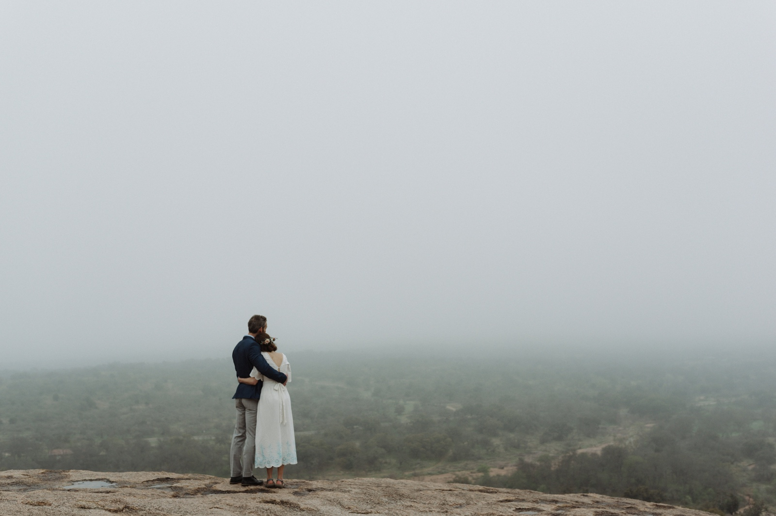 View from the top of Enchanted Rock elopement on a foggy day