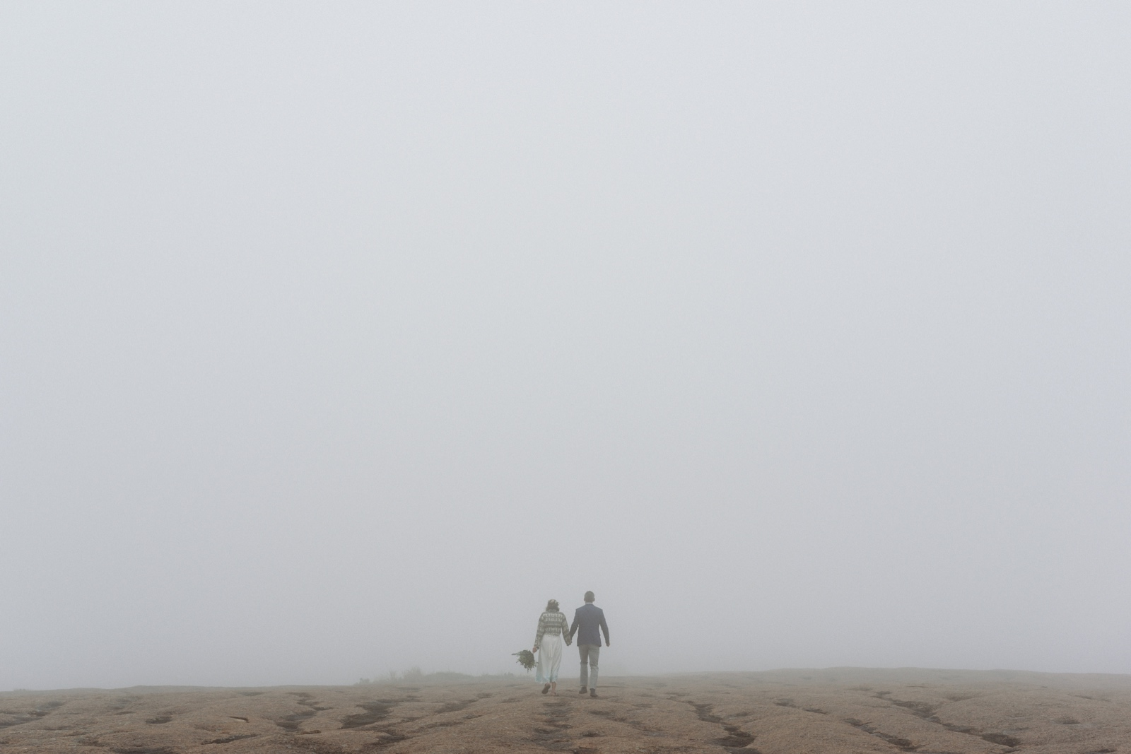 A foggy day for an elopement at the top of Enchanted Rock in Texas