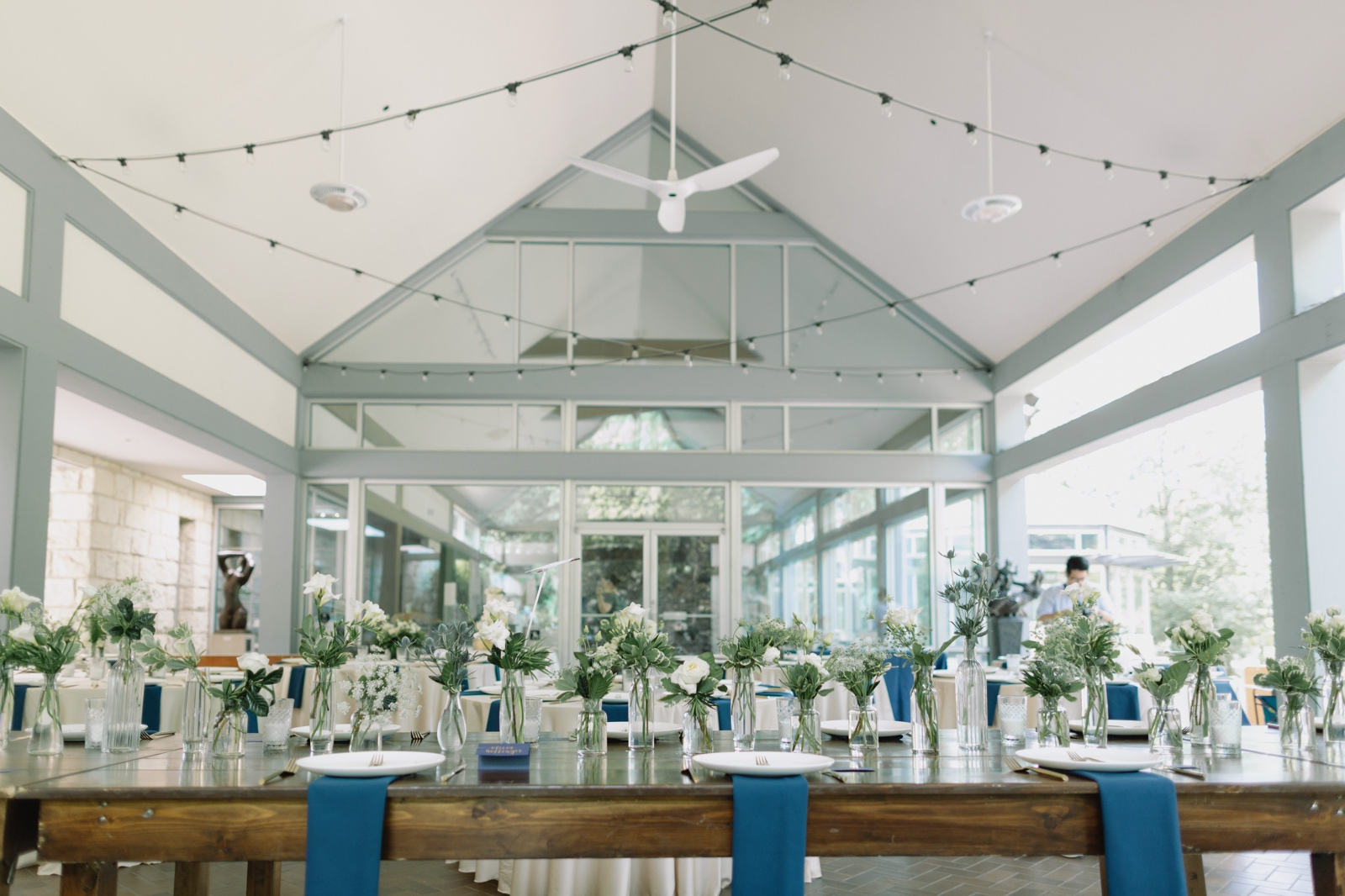 Green and blue wedding reception details in the Umlauf Sculpture Garden pavillion