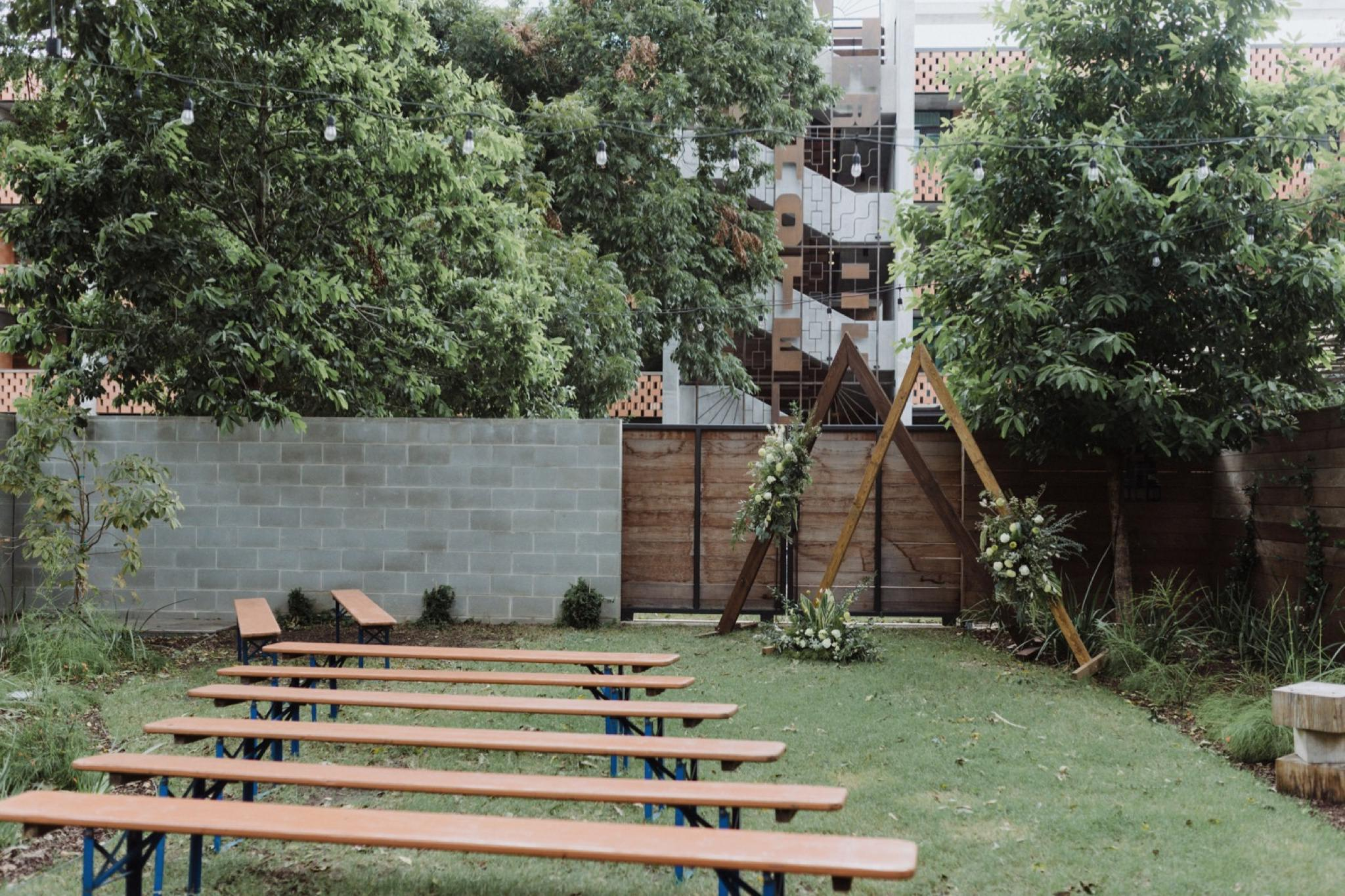 Unique ceremony layout for a backyard Carpenter Hotel Wedding on South Lamar
