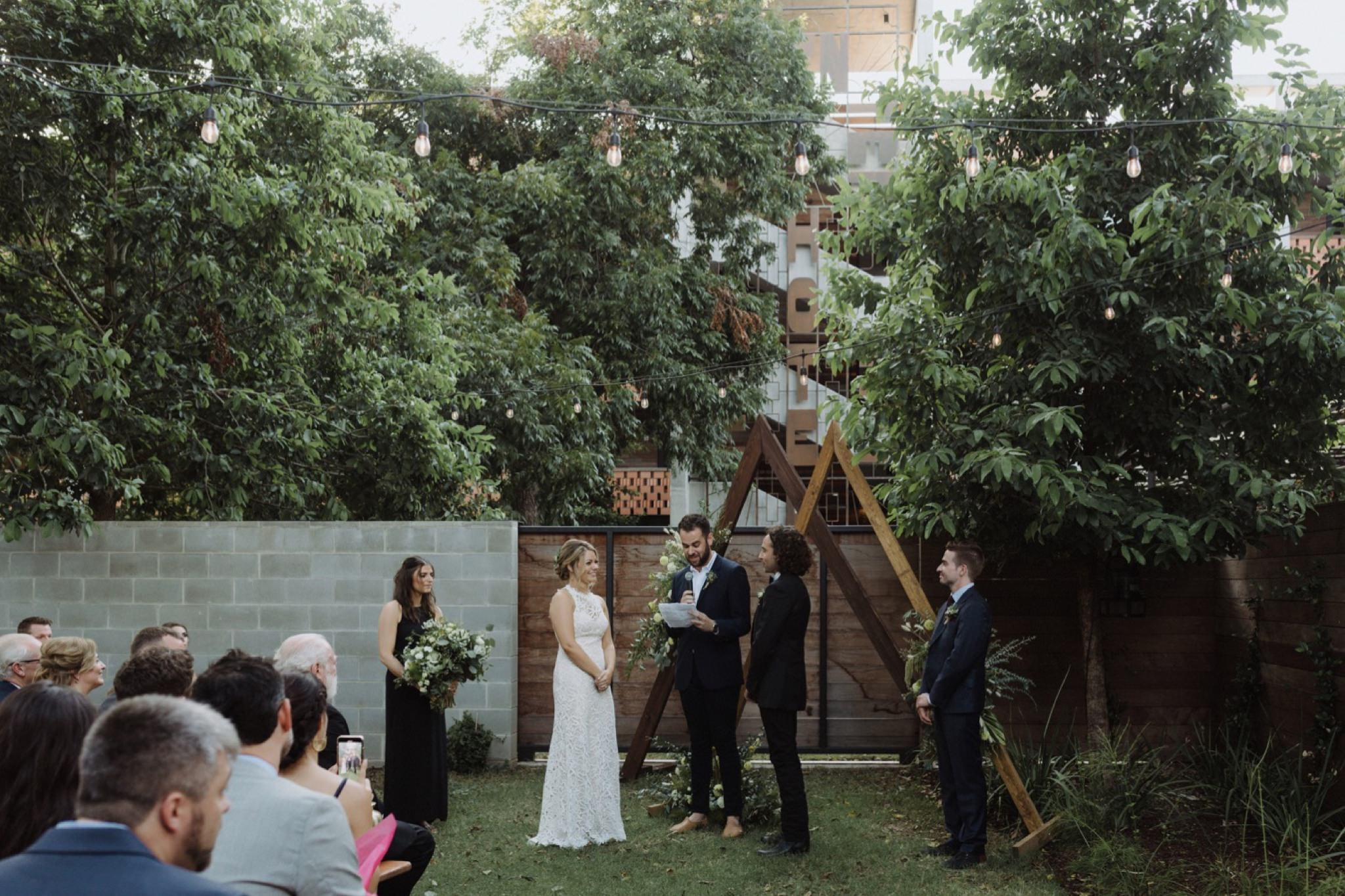 Intimate ceremony for a carpenter hotel wedding with a geometric altar
