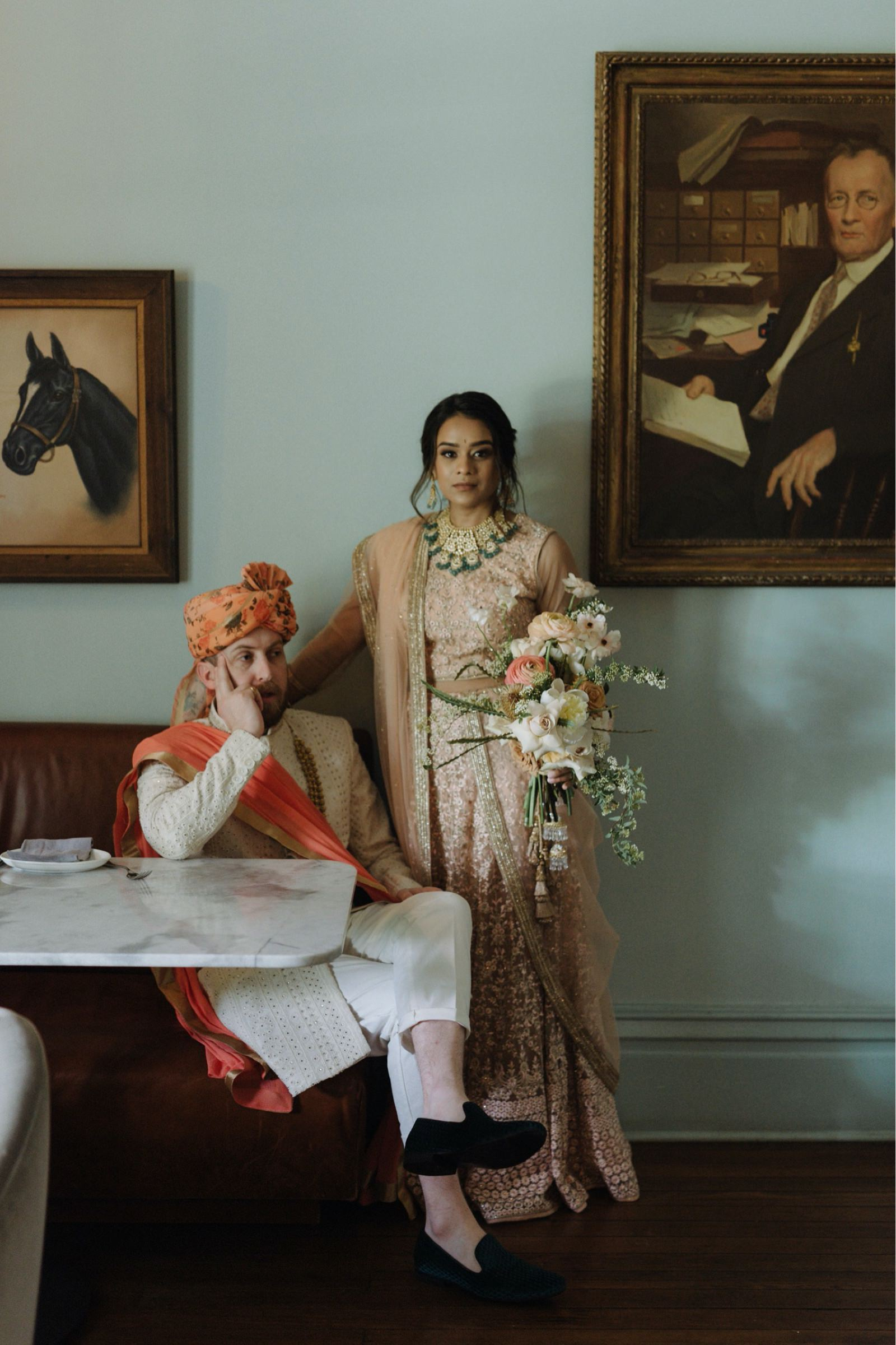 Couple in traditional Indian wedding dress posing classically at Mattie's Austin