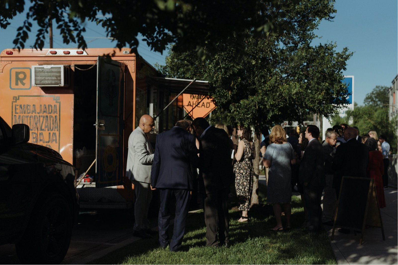 Rosarito's orange taco truck serving guests for a wedding reception in Texas