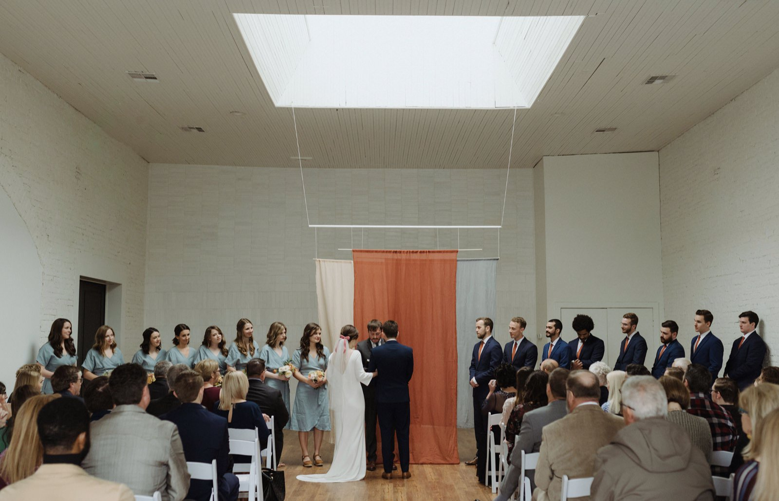 One Eleven East ceremony under the skylight with fabric installation