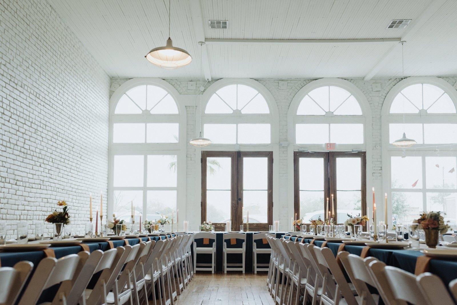 Unique long table reception layout at an urban loft wedding