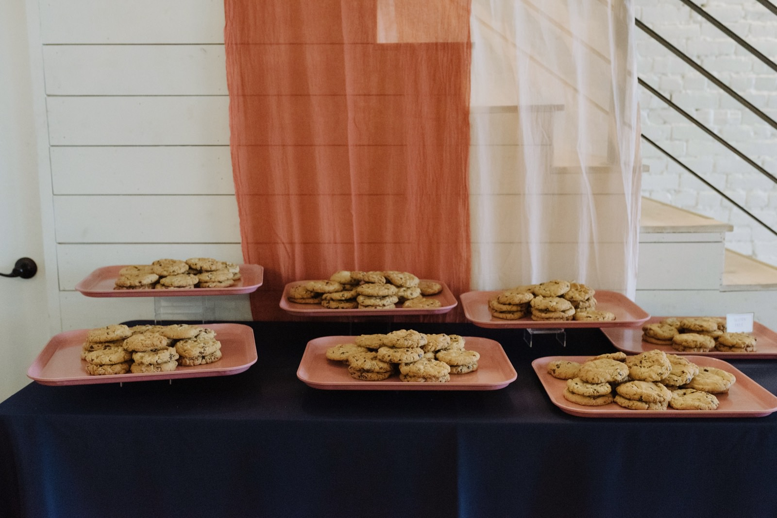 Homemade cookies wedding dessert table served on pink cafeteria trays