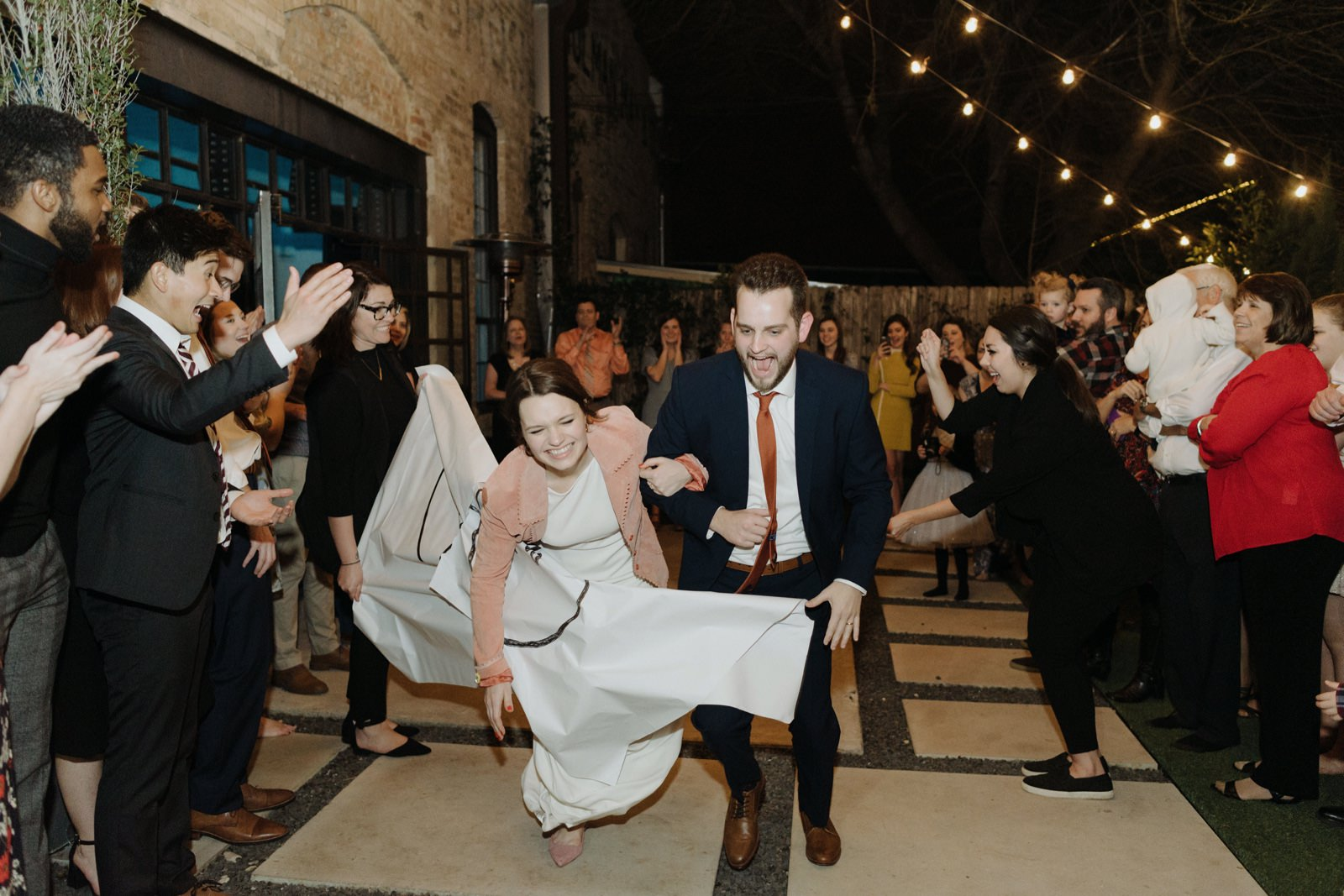 Wedding couple's exit in the coutyard of One Eleven East with celebratory banner