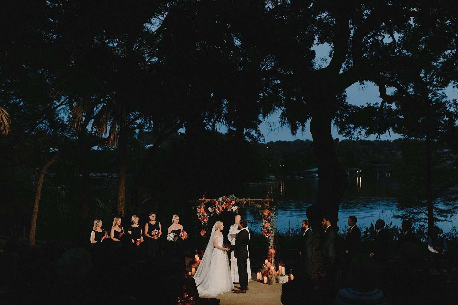 Nighttime amphitheatre wedding ceremony at Austin venue Laguna Gloria