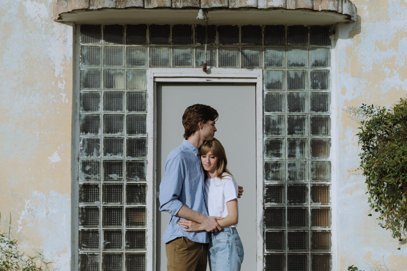 Midcentury building backdrop for an Austin photography engagement session with couple wearing classic denim