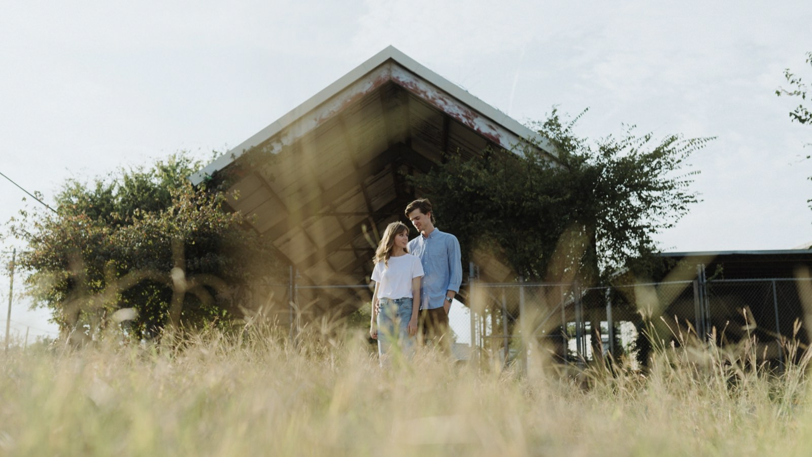 Industrial meadow vibe engagement session in Austin, Texas
