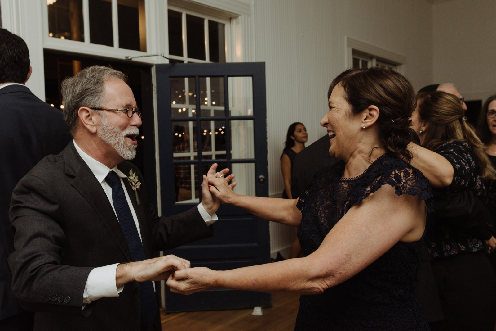 Parents of the bride joyfully ripping up the dance floor at the historic East Austin wedding venue