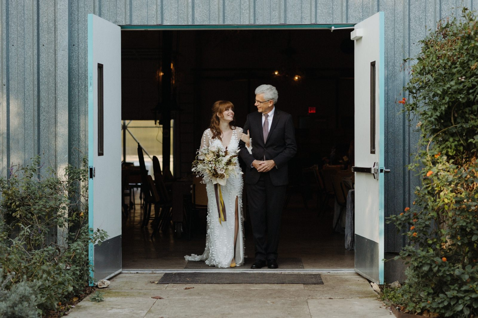 Bride and her father exiting Vuka at Bouldin Creek for the outdoor backyard wedding ceremony